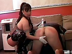 Gorgeous brunette dominant lady oils and fingers anus of guy and then takes strap on to bang him wild.