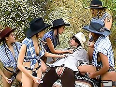 Five sexy cowgirls team up to strapon fuck an eager cowboy outdoors in these videos from Strapon Uniform