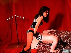 Submissive crossdresser in leather mask and fetish stockings gets strapon-fucked by his gorgeous latex mistress